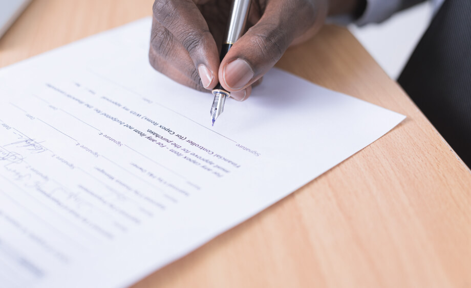 Man is signing a contract